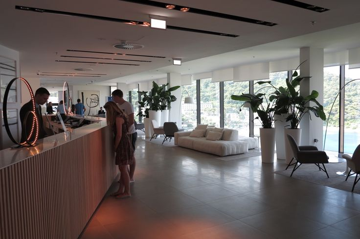 The contemporary lobby area at the Hotel Kompas boasts a floor to ceiling ocean backdrop.