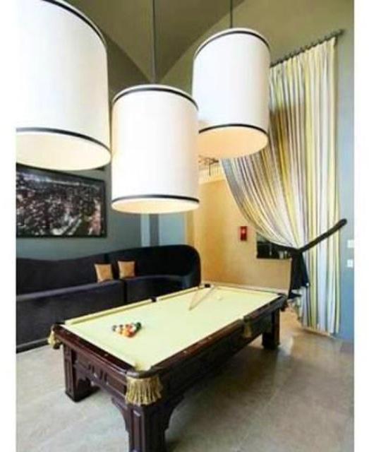 Billiards room. Cool lighting design!