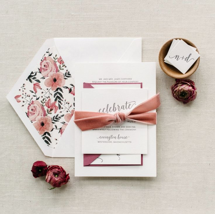 I love the modern font paired with the calligraphy. I also like the dark grey on white paper