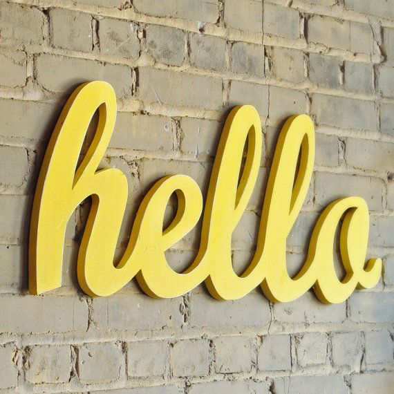 hello sign by Oh Dier--we have this hanging on the wall by our front door.