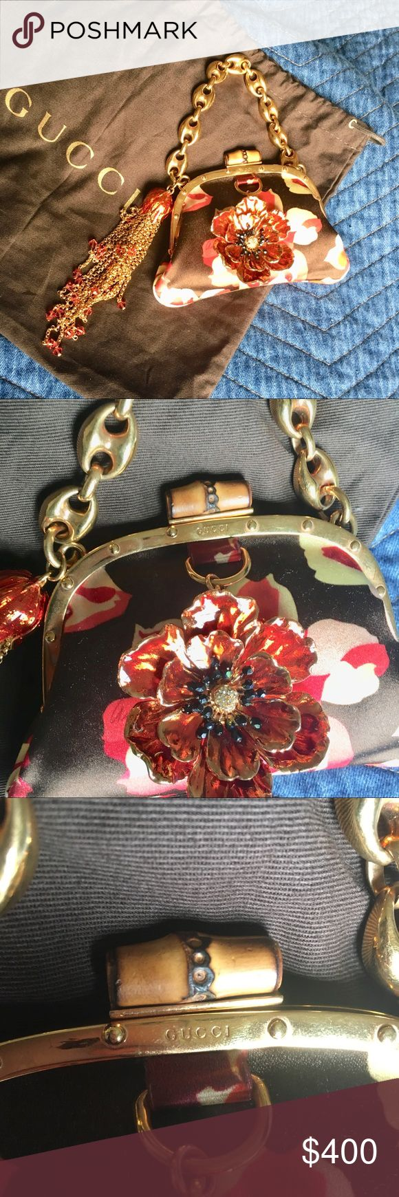 Gucci Jeweled Party Clutch Very Rare to find  💎 Jeweled 💎 100% Authentic Mini Party Clutch, it has golden tone hard ware with one big jeweled flower Charm & gorgeous Tassel Charm comes with Gucci heavy chain as handle, it has Gucci Engraved on its hard ware, the snap comes as bambo!!  it is just Piece of Jewel 💎 you will love as it has been loved, has small snug on back sides & hardware has some unnoticeable scratches. Gucci Bags Mini Bags