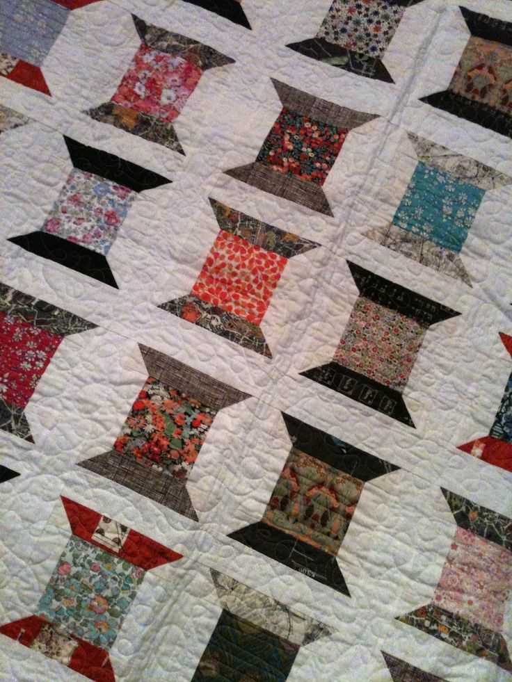 """I guess my great love for quilting and sewing makes my heart warm up at the sight of a Thread Spools quilt! From the little I can see of this one, it looks """"sew"""" perfect to me."""