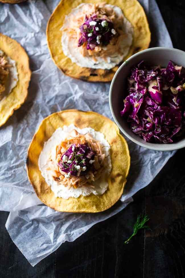 A gluten free and healthy Maille meal by @FoodFaithFit has tostadas, grilled maple salmon, and a Dijon mustard pickle slaw.