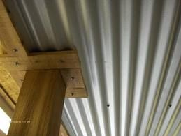 basement ceiling, corrugated metal ceiling.
