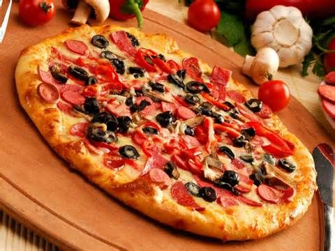 Pizza: pepperoni, olives, pineapple, and mushrooms.