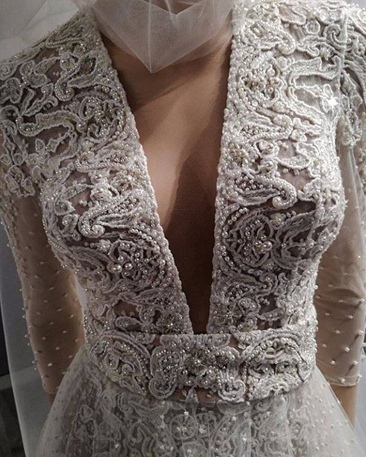Ersa Atelier 2018 hand embroidered french lace plunging V neckline wedding dress. Eveline wedding dress from Miss Mist bridal collection.