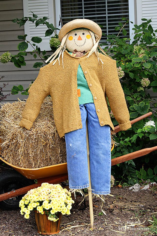DIY scarecrow tutorial for fall decor. She used an inexpensive JoAnn Fabrics' stick scarecrow and thrift store clothing to doll her up!