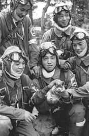 Kamikaze pilots - May 26, 1945. Corporal Yukio Araki, holding a puppy, with four other pilots of the 72nd Shinbu Squadron at Bansei, Kagoshima. Araki died the following day, at age 17, in a suicide attack on ships near Okinawa. he is the youngest pilot