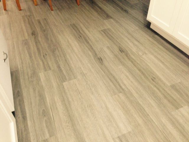 "2mm Luxury Vinyl Planks in ""Savannah Oak"". Installed in a private condo in South Florida. Patriot's Provincial Series is available in a larger 6"" x 48"" plank and makes a bold statement in design, color, and character."