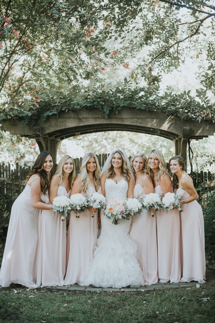 Gorgeous long blush pink bridesmaid dresses (Feather & North Photography)