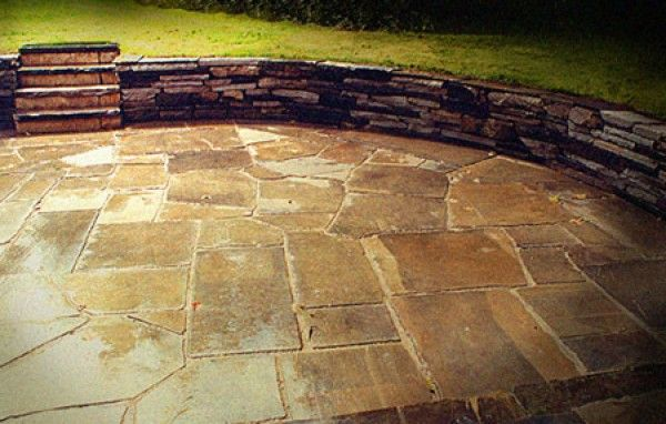 Sunken Stone Patio & Retaining Wall in Shaker Hts., OH created by Hoehnen Landscaping .