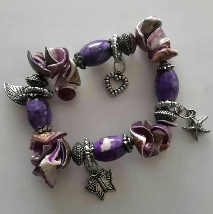 Beaded bracelette with shells and charms