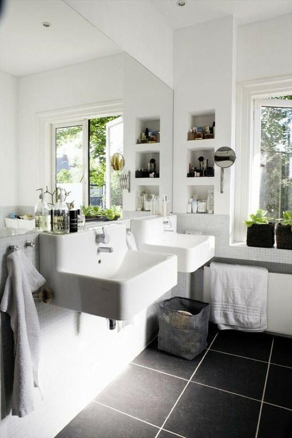 White small bathroom design - love the small cubies in the wall