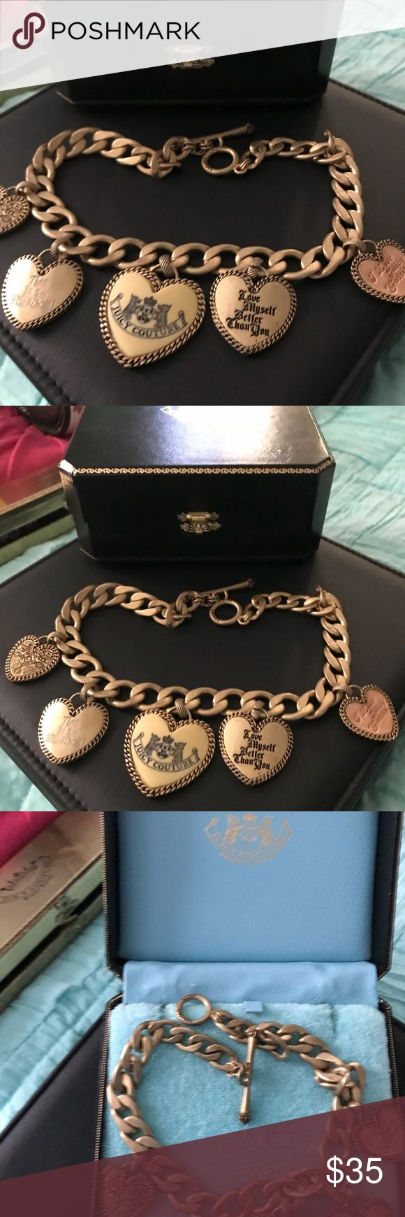 Juicy Couture chunky gold necklace w hearts Juicy Couture gold link chunky necklace with heart charms. This necklace was never worn. Original box included! Juicy Couture Jewelry Necklaces