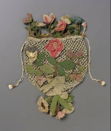 Drawstring bag, ivory fancy openwork netted ground, bibila flowers in relief, bibila flower tassel. MFA Boston