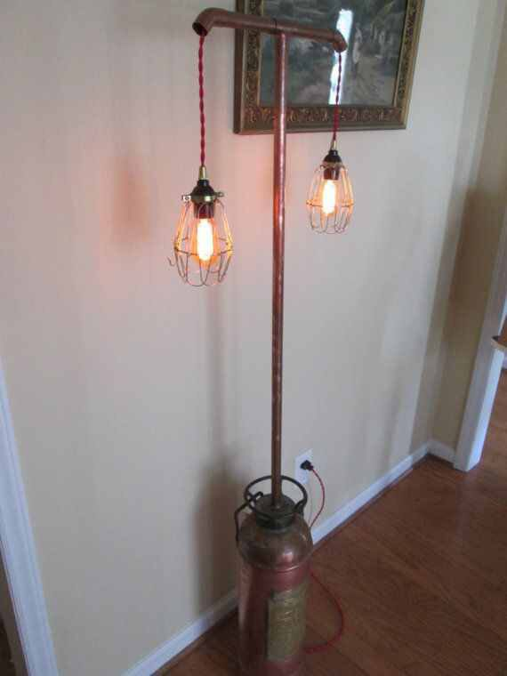 Old #fire extinguisher turned into a light stand, another #DIY exceptional use of old #firefighter equipment & tools.