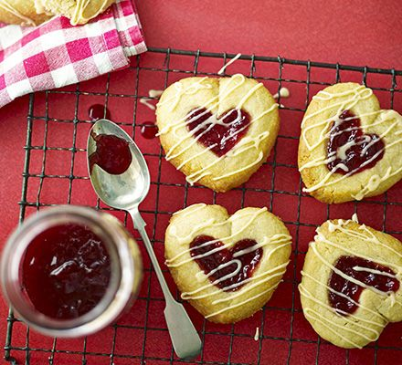 Jammy heart biscuits perfect for valentines.         www.bbcgoodfood.com/recipes/jammy-heart-drops