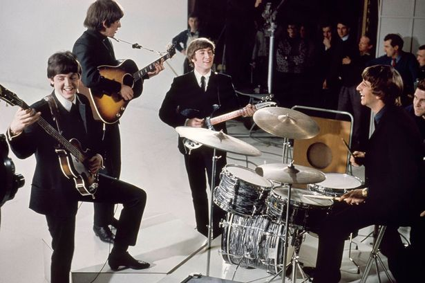The Beatles: Paul McCartney, George Harrison, John Lennon and Ringo Starr on the set