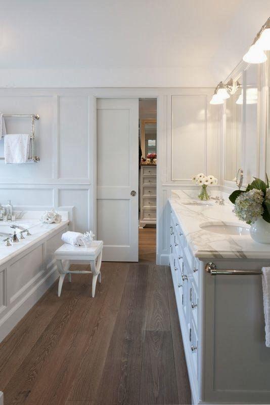 Beautiful Baths * Pocket Door, Marble Counters, Wood Floors and wood bathtub facade. * Haute Indoor Couture