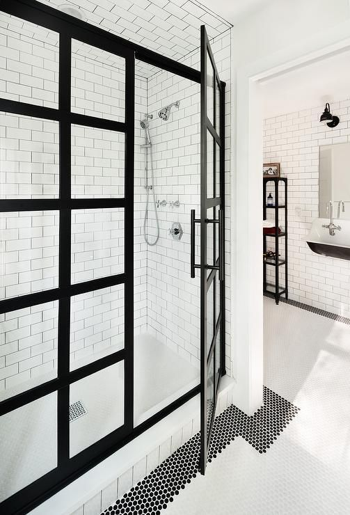 Black and white industrial boys' bathroom boasts black and white floor  tiles framing a walk-in shower fitted with a black steel frame shower  enclosure, ...