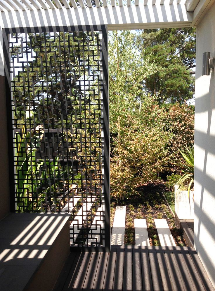 The beautiful 'Tokyo' QAQ screen design in compressed hardwood encloses this patio space.