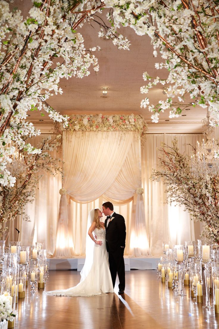 Couple at Elegant Ceremony with Divine Chuppah | Photography: Bob & Dawn Davis Photography. Read More: http://www.insideweddings.com/weddings/glamorous-ivory-blush-spring-wedding-at-a-private-club-in-chicago/685/