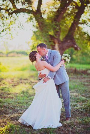 Eberle Barn Venue, Sequim, WA Farm, country chic wedding, farm wedding, bride and groom pose, outdoor wedding, grey suit, bridal pose, green and white bouquet, wedding flowers