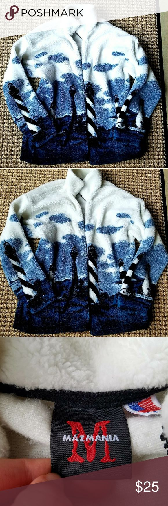 Warm thick zip up sweater Lighthouse warm fuzzy zip up! This is so warm and thick, and cozy! Never worn, great condition! Doesnt say any size, but my guess is XL to L, would fit both great! Mazmania Sweaters