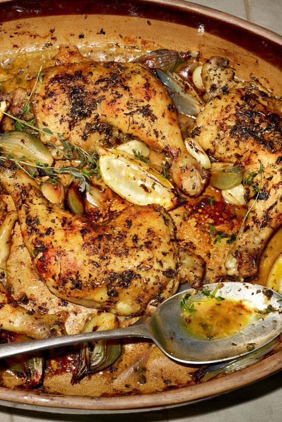 Chicken Thighs ...NYT Cooking:  Perfect dinner-party meal: chicken thighs or legs dusted in flour &roasted with shallots, lemons & garlic&  vermouth. .