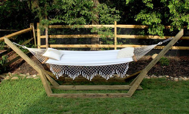 This free-standing wood hammock stand uses basic treated wood posts, screws, and 45 degree angles to create a custom stand for about $60 in material cost.