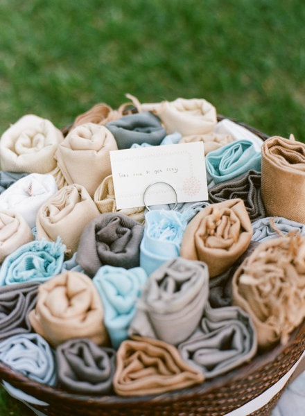 A bucket of shawls is a lovely way to keep your guests warm at any wedding or event. Find shawls like these for rent and/or sale at splendorforyourguests.com!   Splendor for Your Guests | Rental Company | Weddings | Events | Shawls | Blankets | Umbrellas | Parasols | Fans