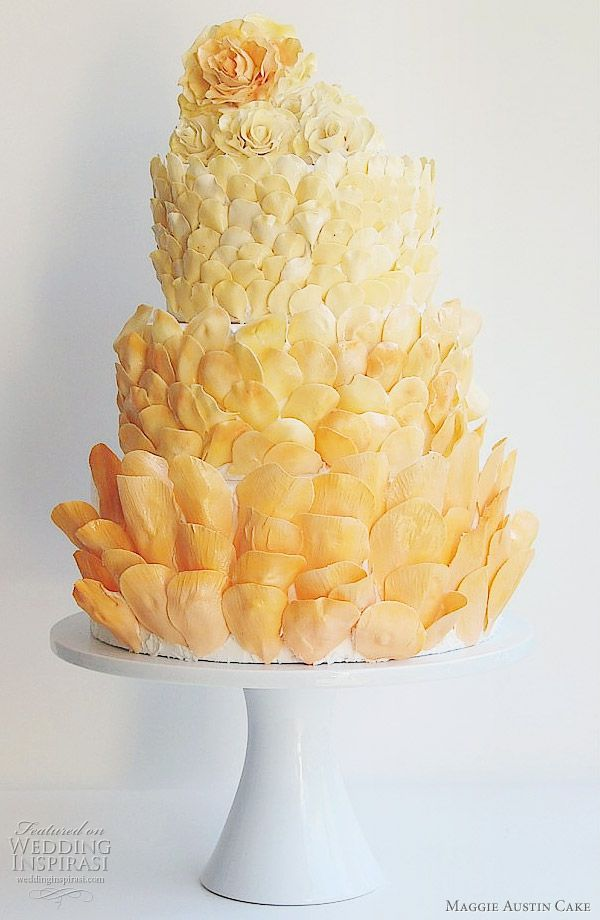 Unique looking cake covered in shades of orange petals. Made by Maggie Austin Cake in the Washington DC area.
