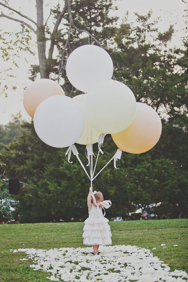 Instead of the traditional unity candle ceremony, close family members tied wishes for the couple onto balloons. The little flower girl brought them up the aisle for the bride and groom to release.