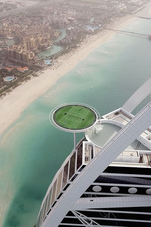No other tennis court in the world has quite the view as the one at the Burj Al Arab hotel in Dubai. Located more than 650 ft (200 m) above ground, the hotel's grass helipad was converted into a 4500 sq ft (415 sq m) tennis court to promote the Dubai Open back in '05.Burj Al Arabic, Dubai, Architecture, Travel, Places, Tennis Court, Hotels, Tenniscourt, Highest Tennis