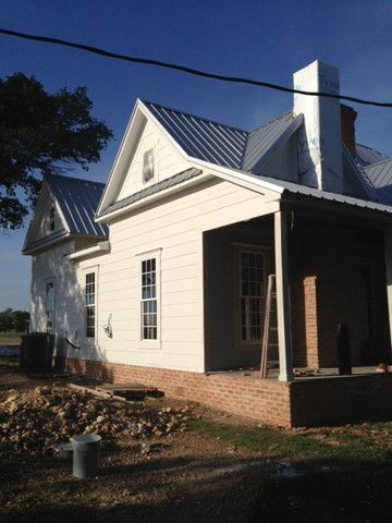 The Magnolia Mom - Joanna Gaines  White farmhouse  Love the old brick foundation against the white siding