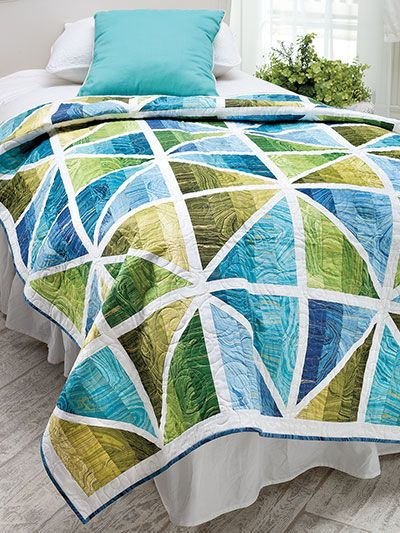 "Use your favorite jelly roll strips to create this unique design. Finished size is 52 1/2"" x 69 1/2"". Also includes an assembly diagram for creating a 92 1/2"" x 115"" version of the quilt (can be made with the leftover jelly roll f..."