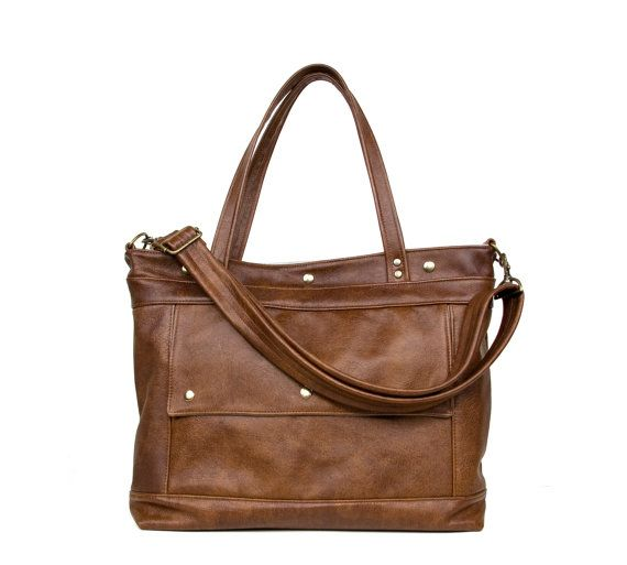 Large handmade leather tote for carrying up to a 17 laptop and more. Its perfect for school, work and play. Also a great stealth diaper bag!