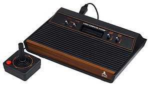 My dad brought home the Atari 2600 one day in the early 80s when I was a child, along with Pac-Man, which all began my video game obsession.  So many hours of Pac-Man, Frogger, Pitfall, Space Invaders, Yar's Revenge and more.  Fortunately, I still played outside a lot so I maintained a good balance of video games and physical activity.  Now, with Kinect, no need to compromise :)