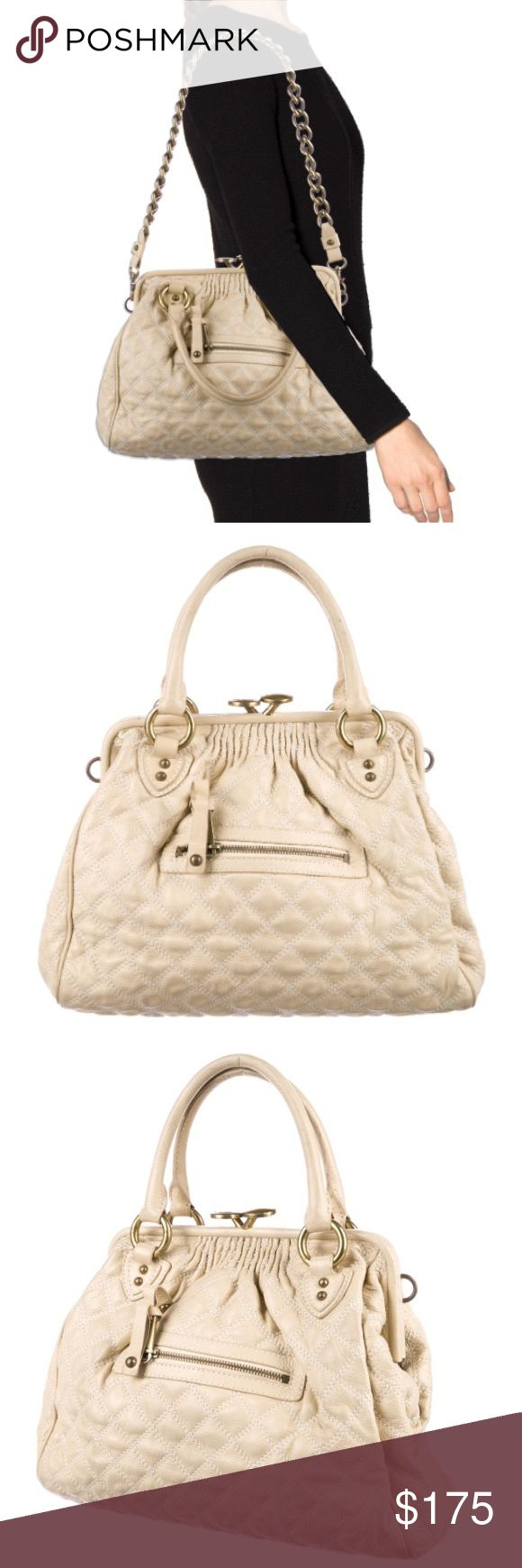 """Marc Jacobs Quilted Leather Stam Bag Purse Beige quilted leather Marc Jacobs Stam bag with brass hardware, dual rolled top handles, optional chain-link shoulder strap, protective feet at base, vermillion canvas lining, single pocket at interior wall with zip closure and kiss-lock closure at top.  100% Authentic Shoulder Strap Drop: 12"""" Handle Drop: 5"""" Height: 11"""" Width: 13"""" Depth: 5"""" Good condition, moderate markings on exterior leather; some tarnishing on the hardware Marc Jacobs Bags…"""