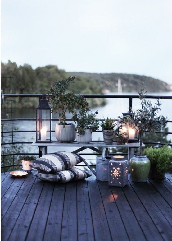 Night lights and flower pots sitting on a patio deck | adamchristopherdesign.co.uk