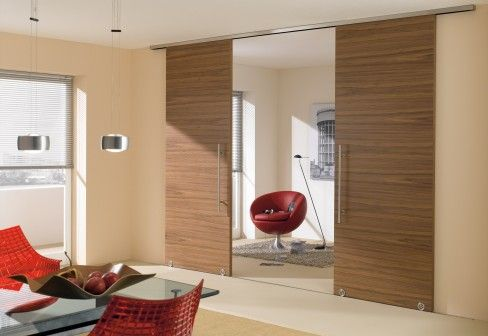 Modern Wooden Surface Mounted Sliding Doors. Love this for our Master Bedrrom to seperate the bedroom and bathroom space.