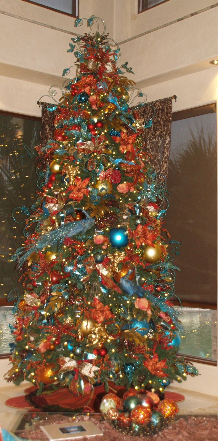 Christmas Trees-#Peacock and #Copper Christmas Tree are beautiful in this Lake side home