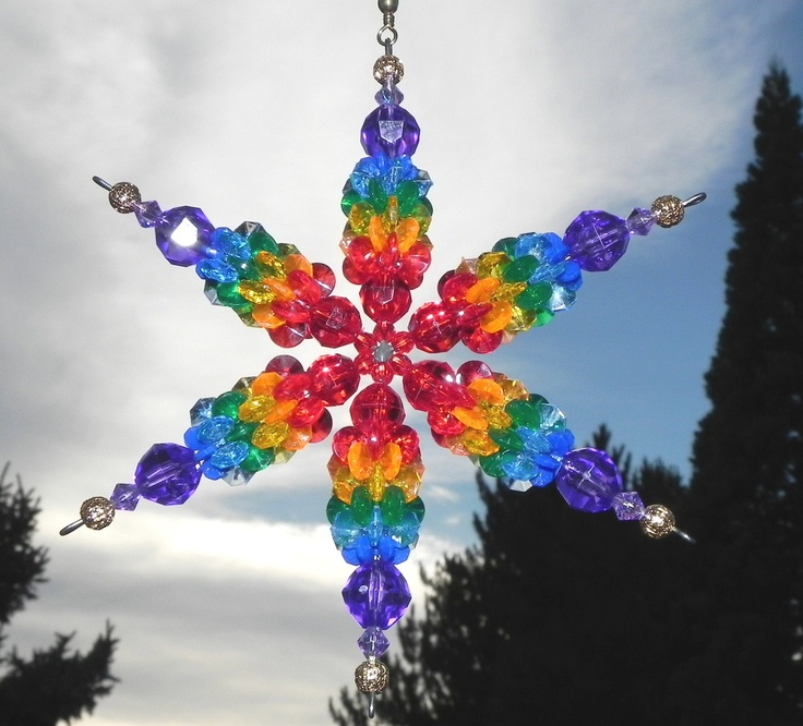 Snowflake Suncatcher Wind Spinner Ornament with Plastic Beads in Rainbow Colors with Gold Tips. $7.50, via Etsy.