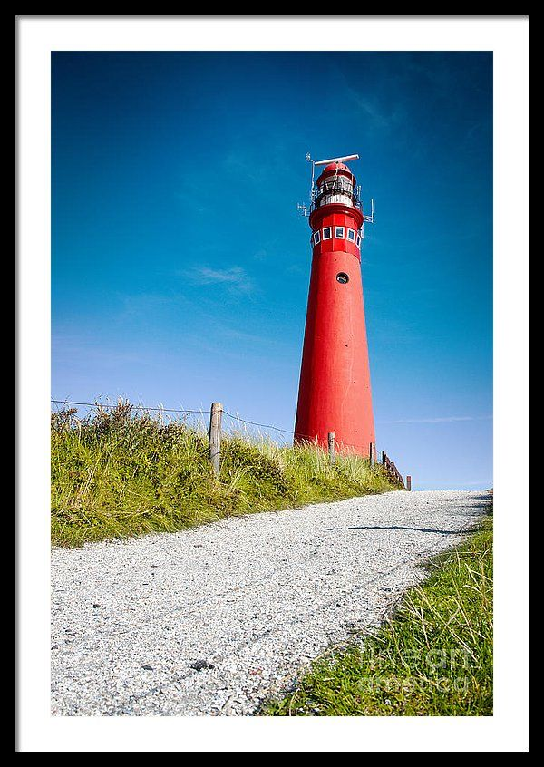 Antenna Framed Print featuring the photograph Red Lighthouse And Deep Blue Sky. by Jan Brons. Red lighthouse and deep blue sky.     Lighthouse found on the island of Schiermonnikoog. The lighthouse, also known as North Tower, was activated in 1854.     Schiermonnikoog belongs to the Unesco Wadden Sea Region. The Wadden Sea stretching from The Netherlands, Germany to Denmark.