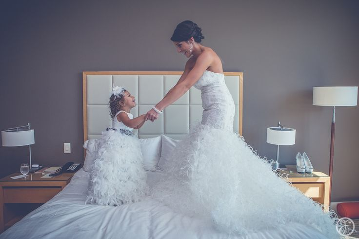 Cute photo idea if you have a daughter and you are getting married... jumping on the bed with her before you say I do! Photo by Forte Photography