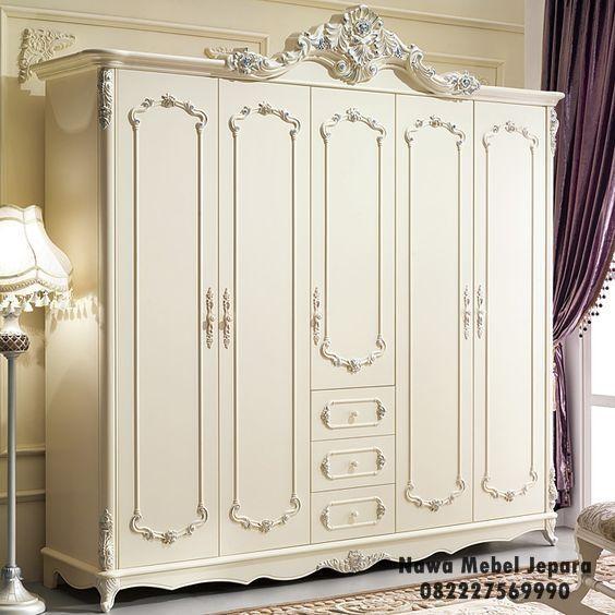 jual almari mewah dengan model minimalis dengan variasi ukiran yang elegan dari furniture jepara, Terbuat dari bahan yang kuat dan elegan dengan warna putih yang terlihat mewah