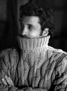 A handsome man in a beautiful hand-knit sweater.  What more is there?