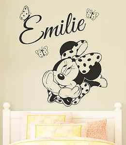 Adorable Minnie Mouse wall decal. Personalised with your childs name and adorned with little polka dot butterflies! Perfect for personalising bedroom walls and nursery's.