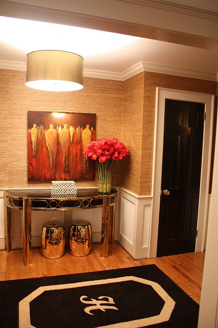 love the grass wallpaper and the monogrammed rug with the gold shade light.