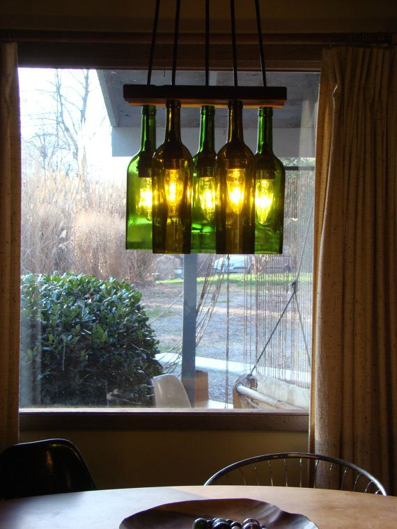 wine bottle chandelier. Love!! Very stylish yet something oldy worldy. Great idea.